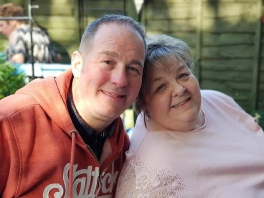 Susan Nelson with nephew Wayne. See SWNS story SWMDfamily; The children of a beloved mum, who died after contracting Coronavirus, believe that up to 17 wider family members have been infected Covid-19 after they all attended a funeral. Susan Nelson, 65, who had no underlying health conditions, died at the Queen Elizabeth Hospital in Birmingham with her husband Robert, 67, at her side.The retired grandmother, who ran a family catering business and a sandwich shop in her native Halesowen, West Mids., displayed symptoms after her aunt?s funeral on Friday March 13. Her condition got notably worse the following week, with the family forced into calling an ambulance. Her son Carl, 42, who now lives in Cleckheaton, Yorks., said: ?She was coughing a lot, very breathless and showing all the traditional symptoms. ?She was admitted to hospital on Monday (16/03) and I spoke to the hospital staff the following day. ?They said the next 48 hours were critical before they called me back a few hours later to say it was very close to the end and one member of the family could be with her.