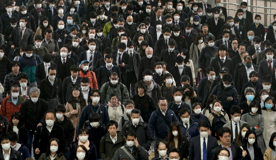 epa08333416 Commuters wear masks on their way to work, at a station in Tokyo, Japan, 31 March 2020. Tokyo Governor Yuriko Koike warned of a possible lockdown after a spike of coronavirus infections amid the ongoing COVID-19 pandemic. Japan has reported nearly 1,500 active cases of COVID-19 as of 31 March. EPA/KIMIMASA MAYAMA