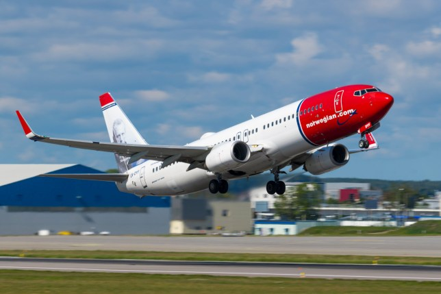 GDANSK, POLAND - SEPTEMBER 3, 2018: Norwegian Air Shuttle airlines offers cheap flights. Airplane Boeing 737-800 takes off on from the International Lech Walesa Airport in Gdansk.; Shutterstock ID 1176630295; Purchase Order: -