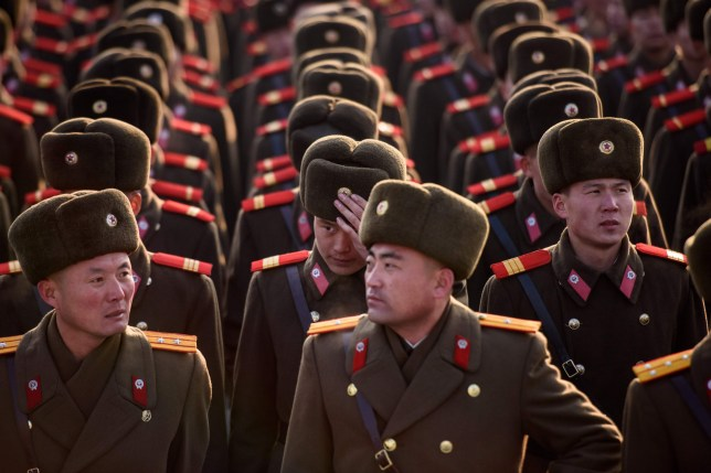 Korean People's Army (KPA) soldiers gather as they prepare to pay their respects before the statues of late North Korean leaders Kim Il Sung and Kim Jong Il as part of celebrations marking the birthday of late North Korean leader Kim Jong Il, known as the 'Day of the Shining Star', on Mansu hill in Pyongyang on February 16, 2019. (Photo by Ed JONES / AFP)ED JONES/AFP/Getty Images