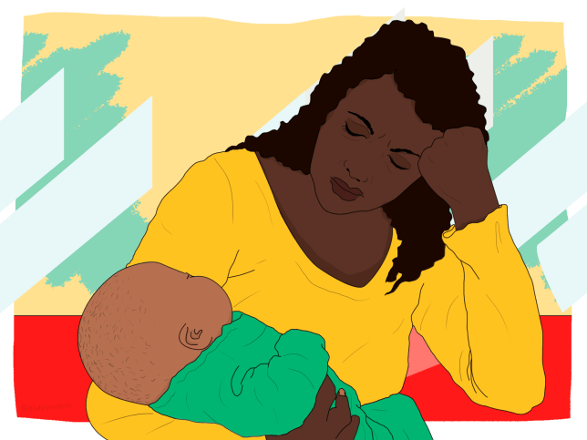 a black woman holding a baby