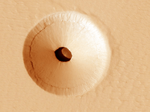 Nasa spots hole on Mars leading to mysterious cavern which could be home to 'Martian life'