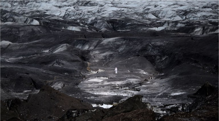 An astronaut tests a spacesuit on a glacier in Iceland (Picture: Benjamin Pothier)