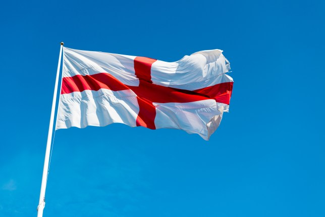 The St George Cross flag of England against a blue sky. (Credits: Getty Images)