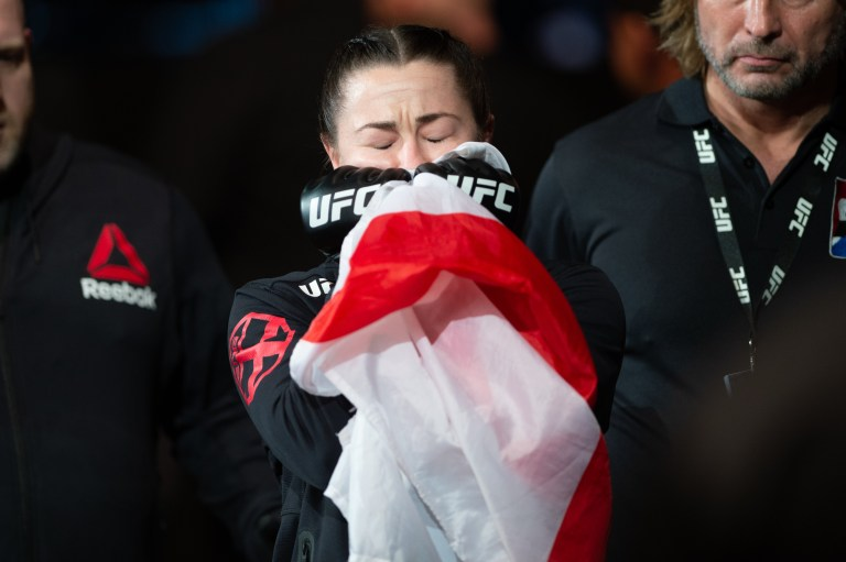 Molly McCann smells the English flag before entering the UFC octagon
