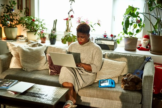 Woman with laptop working at home