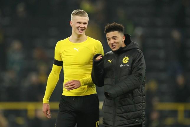 Erling Haaland speaks to Jadon Sancho after a Borussia Dortmund game