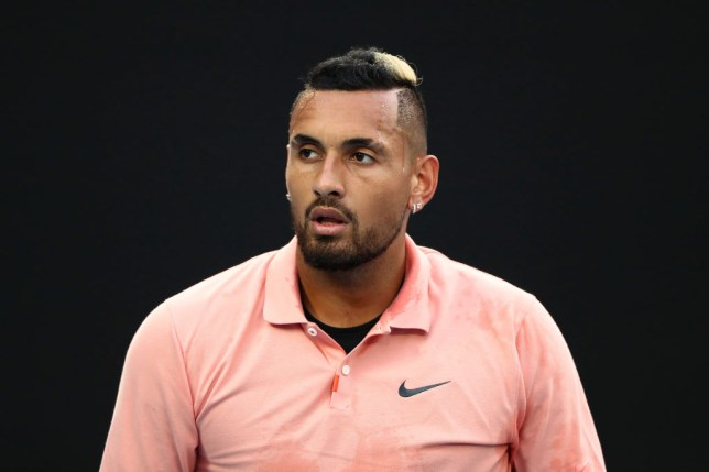 MELBOURNE, AUSTRALIA - JANUARY 27: Nick Kyrgios of Australia looks on during his Men's Singles fourth round match against Rafael Nadal of Spain on day eight of the 2020 Australian Open at Melbourne Park on January 27, 2020 in Melbourne, Australia. (Photo by Kelly Defina/Getty Images)