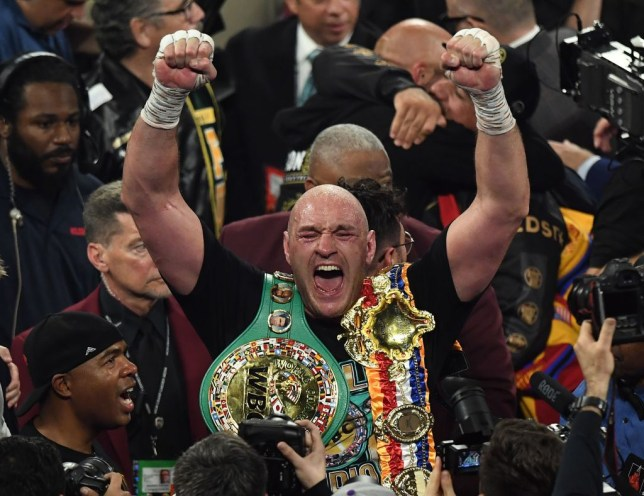TOPSHOT - British boxer Tyson Fury celebrates after defeating US boxer Deontay Wilder in the seventh round during their World Boxing Council (WBC) Heavyweight Championship Title boxing match at the MGM Grand Garden Arena in Las Vegas on February 22, 2020. (Photo by Mark RALSTON / AFP) (Photo by MARK RALSTON/AFP via Getty Images)
