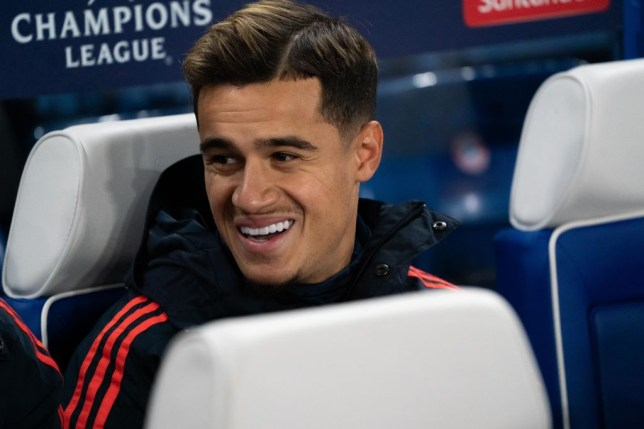 Philippe Coutinho grins on the Bayern Munich bench