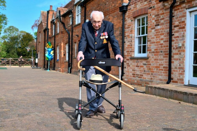 British World War II veteran Captain Tom Moore, 99, poses with his walking frame doing a lap of his garden in the village of Marston Moretaine.