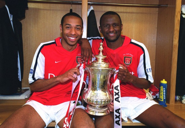 Arsenal greats Thierry Henry and Patrick Vieira pose with the FA Cup trophy after their victory over Chelsea in 2002