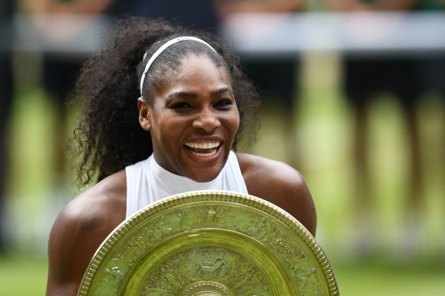 TOPSHOT - US player Serena Williams poses with the winner's trophy, the Venus Rosewater Dish, after her women's singles final victory over Germany's Angelique Kerber on the thirteenth day of the 2016 Wimbledon Championships at The All England Lawn Tennis Club in Wimbledon, southwest London, on July 9, 2016. / AFP PHOTO / GLYN KIRK / RESTRICTED TO EDITORIAL USE        (Photo credit should read GLYN KIRK/AFP via Getty Images)