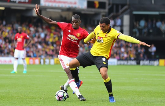 Paul Pogba of Manchester United and Troy Deeney of Watford