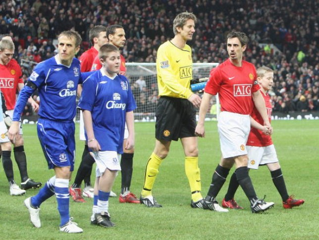 Gary Neville of Manchester United and Phil Neville of Everton