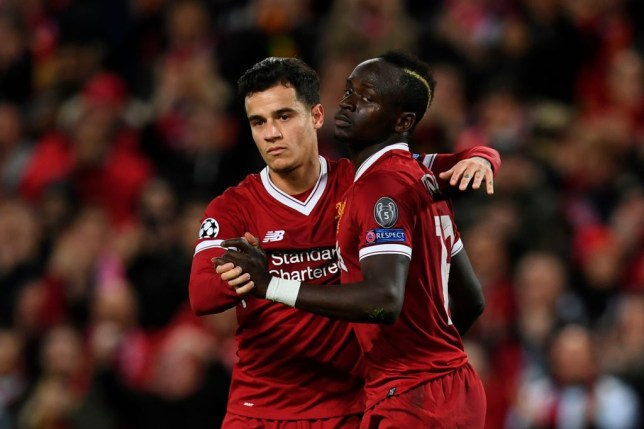 Liverpool's Senegalese midfielder Sadio Mane (R) celebrates scoring their sixth goal with Liverpool's Brazilian midfielder Philippe Coutinho (L) during the UEFA Champions League Group E football match between Liverpool and Spartak Moscow at Anfield in Liverpool, north-west England on December 6, 2017. / AFP PHOTO / Paul ELLIS        (Photo credit should read PAUL ELLIS/AFP via Getty Images)