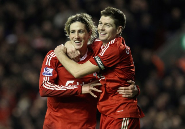 LIVERPOOL, ENGLAND - DECEMBER 16:   Fernando Torres of Liverpool is congratulated by team mate Steven Gerrard (R) after scoring his team's second goal during the Barclays Premier League match between Liverpool and Wigan Athletic at Anfield on December 16, 2009 in Liverpool, England. (Photo by Mark Thompson/Getty Images)