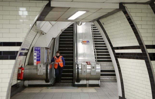 A member of staff in London's Warren Street Station as some 40 Underground stations that do not interchange with other lines have been closed on the Tube network, now running a reduced service in the capital to assist critical workers