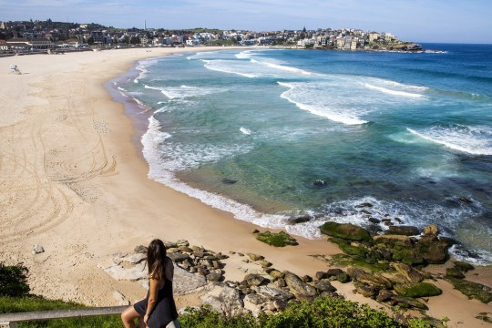 SYDNEY, AUSTRALIA - March 22: A general view of an enclosed Bondi Beach is seen on March 22, 2020 in Sydney, Australia. Prime Minister Scott Morrison on Friday introduced new measures to help stop the spread of the coronavirus (COVID-19), implementing new rules limiting the number of people inside a site to one every 4 square meters. Non-essential gatherings of 100 or more people indoors are prohibited, as well as outdoor gatherings of more than 500 people to contain the spread of COVID-19. A travel ban for all visitors who are not Australian citizens or residents or their direct connections arriving in the country is now in effect. There are now 1286 confirmed cases of COVID-19 in Australia and 7 deaths. (Photo by Jenny Evans / Getty Images)