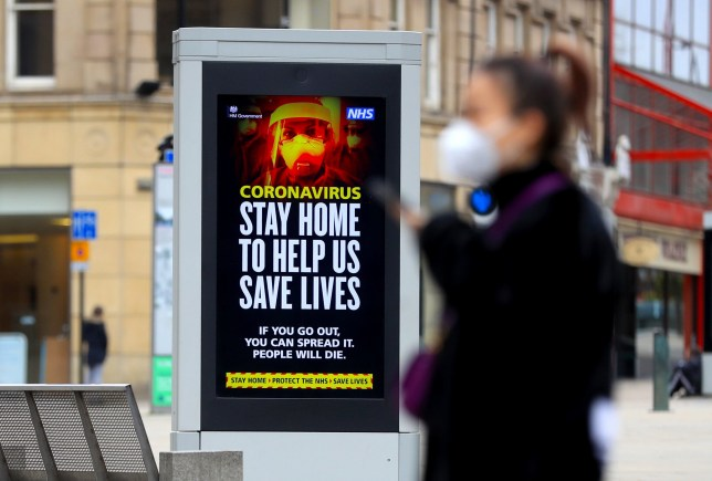 Electronic bilboards displays a message warning people to stay home