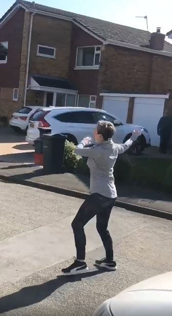Woman leads her entire street in a socially distant dance every morning
