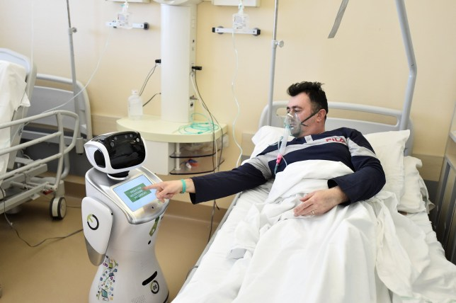 A robot helping medical teams treat patients suffering from the coronavirus disease (COVID-19) is pictured at a patient's room, in the Circolo hospital, in Varese, Italy April 1, 2020. REUTERS/Flavio Lo Scalzo