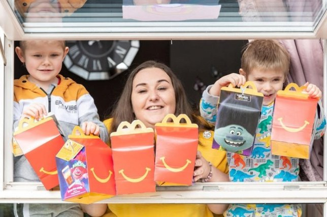 Donna Ganson and her two sons Luke, 5, and Jake, 4. .See SWNS story SWSChappy. A creative mum made homemade Happy Meals complete with packaging and toys to give her two autistic sons their favourite treat during lockdown. Donna Ganson, 33, was devastated when it was announced McDonald's would be closing as she feared her two small boys, Luke, aged five, and Jake, aged four, would pester her for days about going to the drive-thru. The little boys are both on the autistic spectrum, and part of their routine is a trip to the McDonald's drive-thru in Corstorphine, Edinburgh, once a week. But the imaginative mum had the idea of creating a 'drive-thru' in her own home - and was stunned by the generosity of fast food workers, who donated Happy Meal toys and packaging so she could carry on the routine.