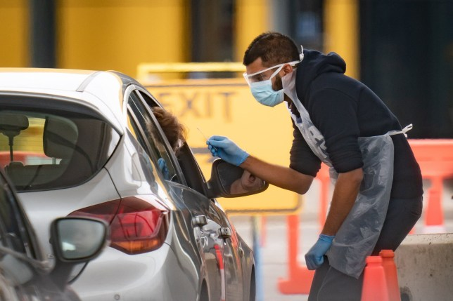 medical staff at an NHS drive through coronavirus disease (COVID-19) testing facility in an IKEA car park, Wembley