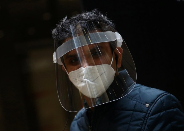 A man wearing a protective mask and visor is seen in London, as the spread of the coronavirus disease (COVID-19) continues, London, Britain, April 13, 2020. REUTERS/Hannah McKay