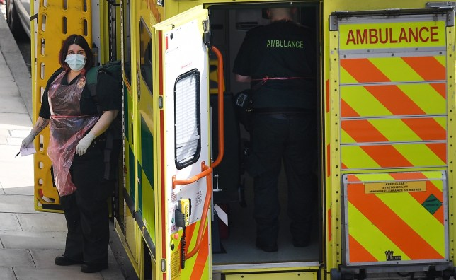 epa08360694 NHS ambulance staff arrive at a call out in London, Britain, 13 April, 2020. Countries around the world are taking increased measures to stem the widespread of the SARS-CoV-2 coronavirus which causes the Covid-19 disease. EPA/ANDY RAIN