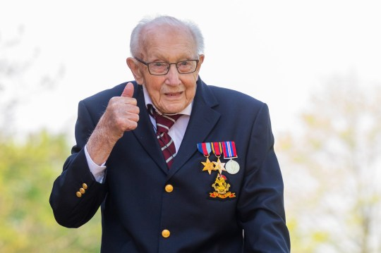 epa08365894 99-year-old British veteran Captain Tom Moore reacts outside his house after completing the 100th length of his back garden in Marston Moretaine, Bedfordshire, Britain, 16 April, 2020. Captain Tom Moore has raised over ??12 million for Britain's National Health Service (NHS) and has received donations to his fundraising challenge from around the world. EPA/VICKIE FLORES