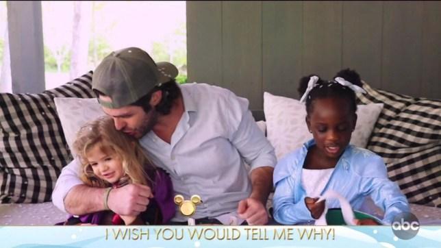 Thomas Rhett and his daughters in Disney Family Singalong