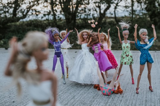 PIC FROM Kennedy News / Agnieszka Marsh (PICTURED: PHOTOS FROM BARBIE AND LOUIS TOMLINSON'S WEDDING SHOOT DONE BY PHOTOGRAPHER AGNIESZKA MARSH AND HER FAMILY WHILE SHE WAS BORED IN LOCKDOWN) A bored wedding photographer who was gutted when coronavirus saw all her bookings cancelled decided to create her own elaborate ceremony to snap - with Barbie and One Direction dolls. Agnieszka Marsh and her husband Ryan Marsh spent a whole day doing a full wedding shoot as if it was a real ceremony - including morning 'getting ready' shots, the afternoon service and nighttime reception. The hilarious photoshoot is handled in the same meticulous and arty manner as all of Agnieszka's shoots - but instead feature a Louis Tomlinson doll as groom shaving before the ceremony and the Barbie doll bride being dressed by her bridesmaids. DISCLAIMER: While Kennedy News and Media uses its best endeavours to establish the copyright and authenticity of all pictures supplied, it accepts no liability for any damage, loss or legal action caused by the use of images supplied and the publication of images is solely at your discretion. SEE KENNEDY NEWS COPY - 0161 697 4266