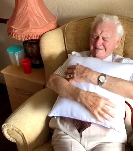 (Picture: Thistleton Lodge/Caters) This is the heartwarming moment a nursing home resident teared up after receiving a pillow printed with a photograph of his late wife. Resident at Thistleton Lodge nursing home in Preston, UK, Ken Benbow, 94, had been married to his wife Ada Benbow for 75 years when she sadly passed away in 2019. In April 2020, Ken received a touching gift from the staff at Thistleton Lodge. Worker at the care house Kia Mariah Tobin gave Ken a pillow with Ada's photograph printed on it, and the man broke into tears in a video that has since gone viral with over 200,000 views.