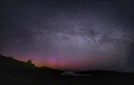 The Northern Lights, the Milky Way and Lyrid meteors falling through the sky at the Bathing House near Howick, Northumberland