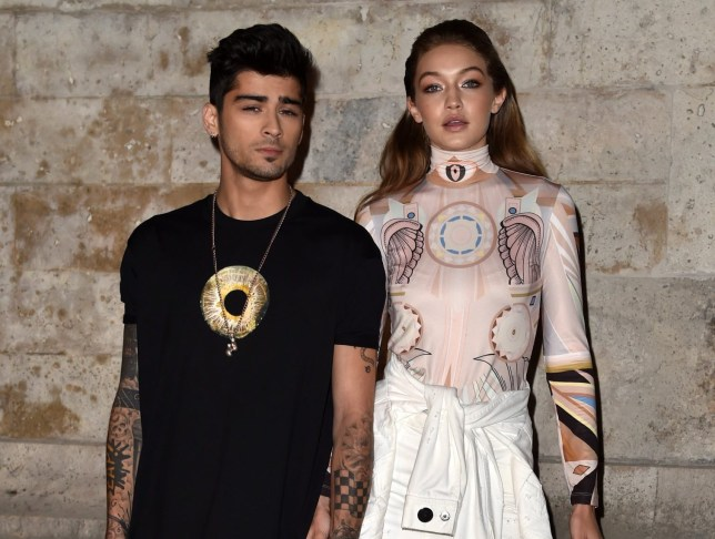 FILE - APRIL 28: TMZ has reported that model Gigi Hadid and singer Zayn Malik are expecting a child together. PARIS, FRANCE - OCTOBER 02: Zayn Malik and Gigi Hadid attend the Givenchy show as part of the Paris Fashion Week Womenswear Spring/Summer 2017 on October 2, 2016 in Paris, France. (Photo by Pascal Le Segretain/Getty Images)