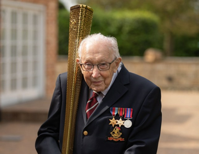 Handout photo dated 29/04/20 issued by Emma Sohl/Capture The Light Photography showing Captain Tom Moore celebrating his 100th birthday by carrying the 2012 Olympic torch, as he completes a lap of his garden. The torch - sent to him from Virgin Radio presenter Chris Evans - is believed to be the only one in existence that can still be lit. PA Photo. Issue date: Thursday April 30, 2020. Captain Tom Moore has already raised nearly ??30 million by walking 100 laps of his garden for NHS Charities Together, that is supporting NHS staff and volunteers during the COVID-19 pandemic. See PA story HEALTH Coronavirus. Photo credit should read: Emma Sohl/Capture The Light Photography/PA Wire NOTE TO EDITORS: This handout photo may only be used in for editorial reporting purposes for the contemporaneous illustration of events, things or the people in the image or facts mentioned in the caption. Reuse of the picture may require further permission from the copyright holder.