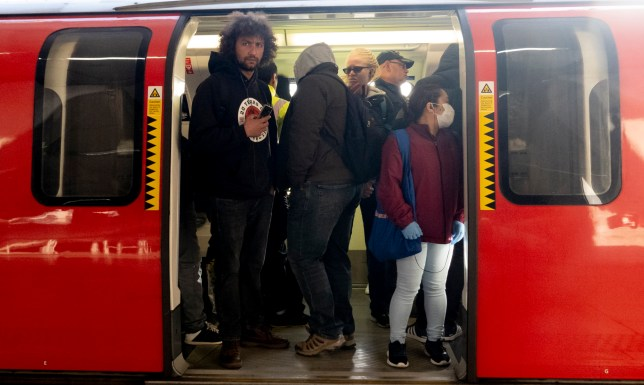 Caption: Date: 30/04/20 Pictured: Passengers at Canning Town underground Station, Caption: Commuters Travel on London's underground network this morning The prime Minister Boris Johnson has said pubic should stay at home to slow the covid-19 / coronavirus spread.