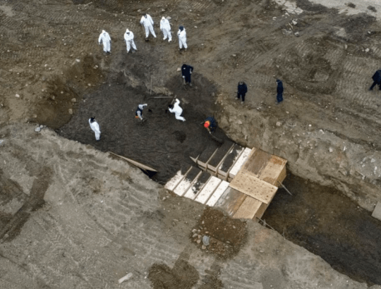 Coronavirus victims' bodies are pictured being buried on New York City's Hart Island