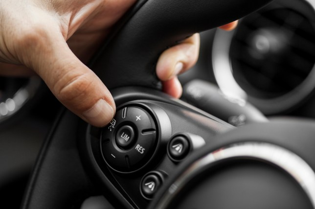 A hand on a steering wheel