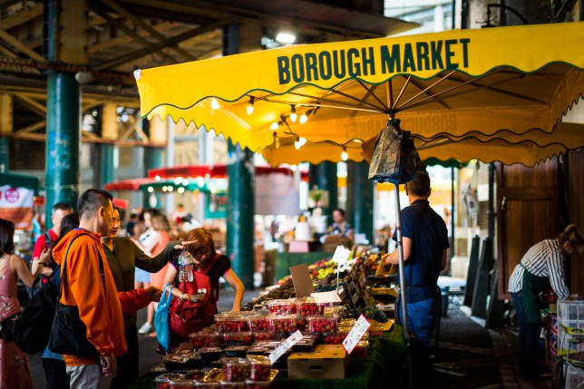 Market stall selling fresh fruit and vegetables at Borough Market, London
