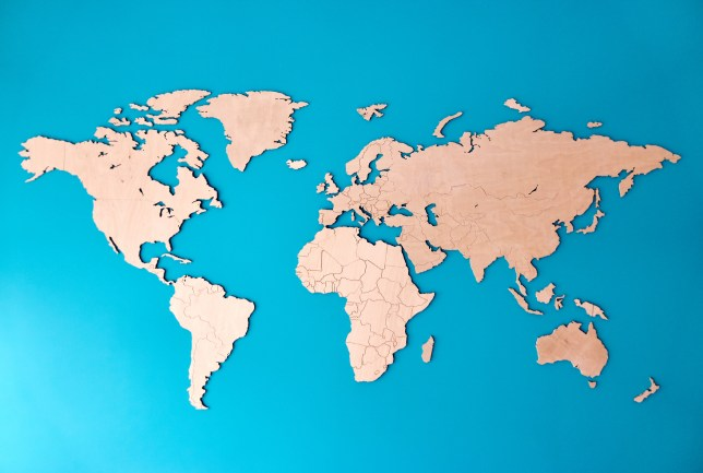 Plywood world map on the blue wall.