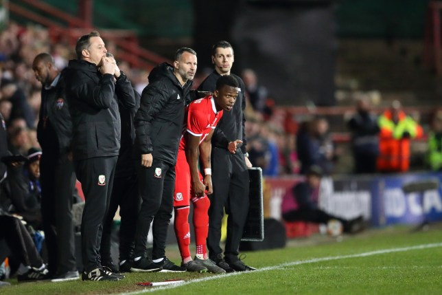 Manchester United legend Ryan Giggs and Rabbi Matondo during Wales' clash with Trinidad and Tobago