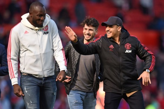 Romelu Lukaku and Alexis Sanchez share a joke ahead of Manchester United's Premier League match with Cardiff