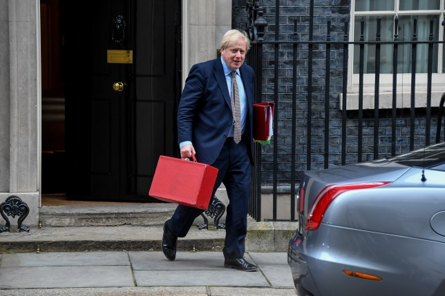 British Prime Minister Boris Johnson leaves 10 Downing Street as he makes his way to the House of Commons to attend Prime Minister Questions.