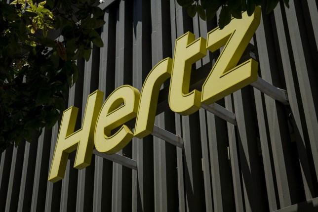 Hertz business logo on building