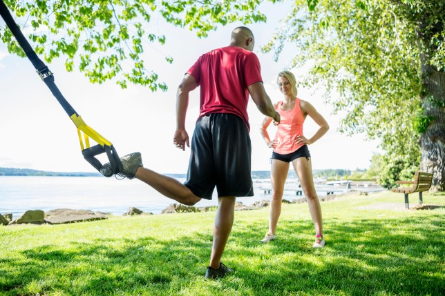 Caucasian man working with trainer outdoors