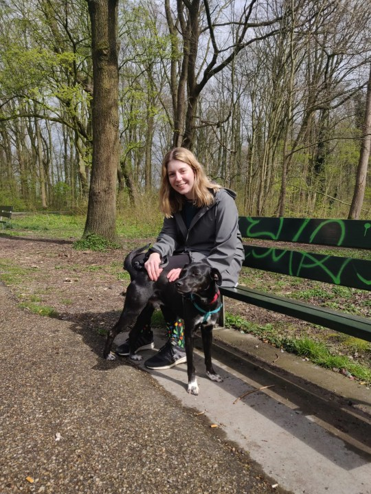 Lily Howes sat on a park bench with her adopted dog, Socks.