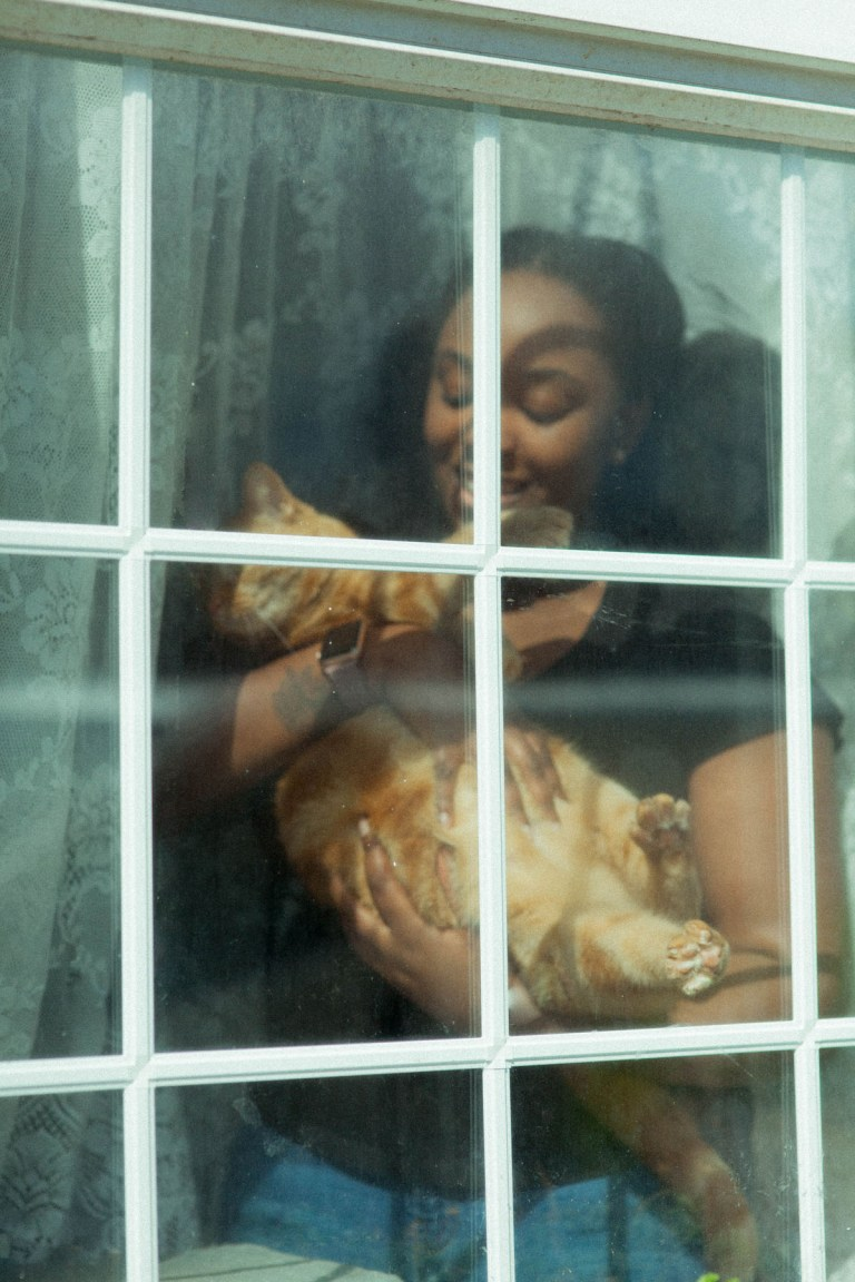Fran Nelson's doorstep portraits: Rebecca and her cat Alani
