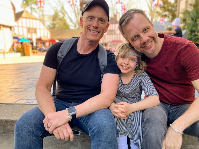 Mark Loewen with his daughter and husband